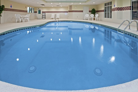 Indoor pool with fresh towels by the door
