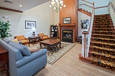 Welcoming lobby with seating around the fireplace