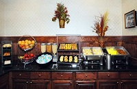 Breakfast bar with hot dishes and fruit