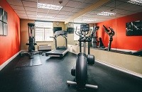 Fitness center with a treadmill, an elliptical and a multi-gym