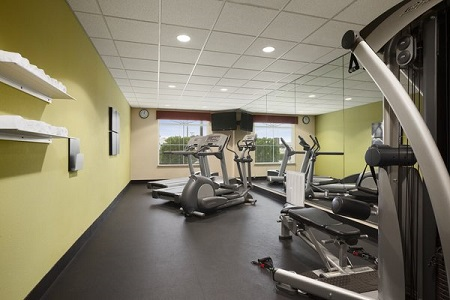 Fitness center with treadmills and weight machine