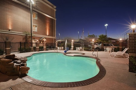 Outdoor pool and hot tub in College Station