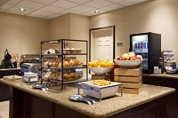 Free, hot breakfast with bagels, fresh fruit and muffins