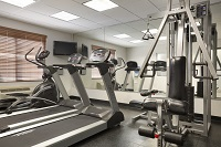 Weight bench and treadmills in our Irving fitness center