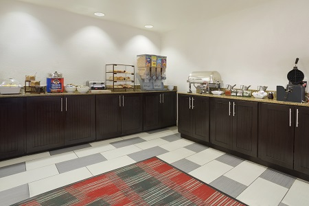Hotel dining area with white and gray tile flooring