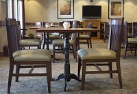Tables and chairs in the hotel dining area
