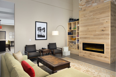 Spacious hotel lobby with fireplace and seating