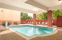 Houston airport hotel's outdoor pool with seating area