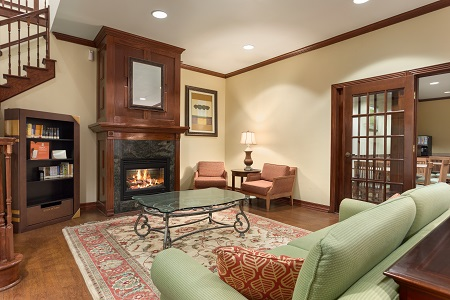 Hotel lobby with fireplace and comfortable seating