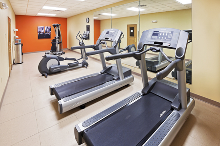 Hotel fitness center with two treadmills and an elliptical