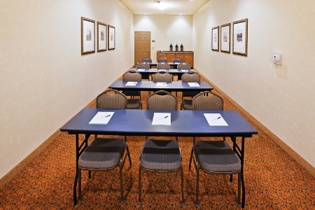 Four rows of tables in Midland, TX meeting room