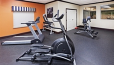 Fitness center with treadmill and free weights