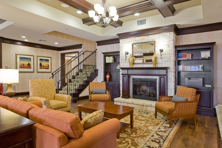 Spacious lobby with fireplace and seating in San Marcos
