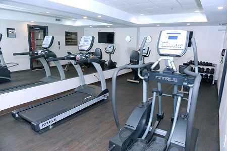 Fitness center with two treadmills and free weights