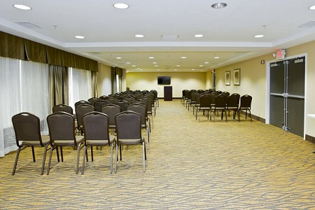 Meeting room with rows of chairs facing lectern