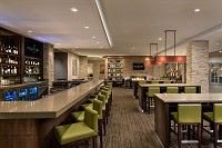 On-site Bistro with green stools and a lengthy bar