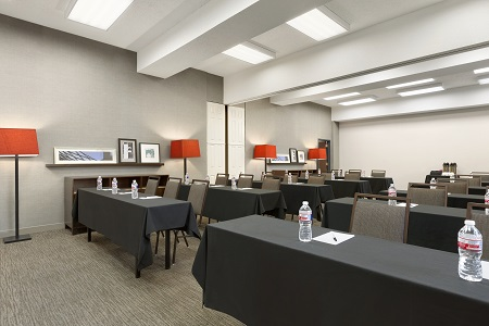 Austin meeting room with tables and floor lamps