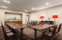 Meeting room with tables in U-shape setup