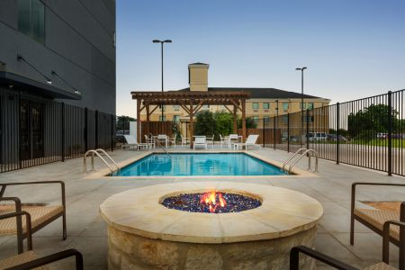 Outdoor swimming pool with fire pit