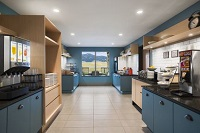 Breakfast area with blue cabinetry and mountain view