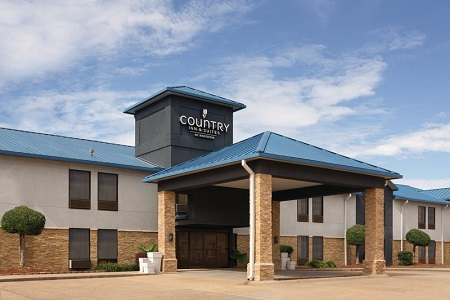 Country Inn & Suites, Bryant (Little Rock), AR exterior with a carport