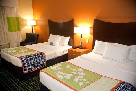 Brookings hotel room with two queen beds and green decor