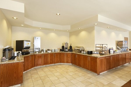 Breakfast room with coffee station, juice dispenser and waffle-makers