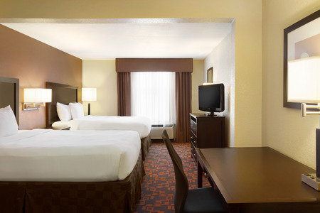 Cordova hotel room with two queen beds, a work desk and a flat-screen TV