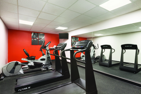 Hotel's fitness room featuring cardio equipment