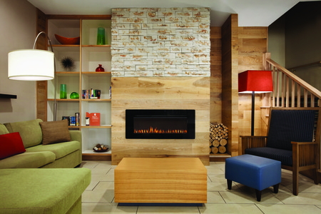 Hotel lobby with comfortable seating and a fireplace