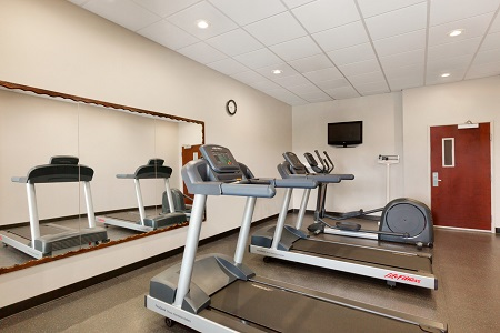 Two treadmills and an elliptical machine in the fitness center