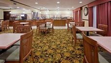 Hotel dining room with breakfast counter, tables and chairs