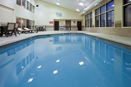 Coon Rapids hotel's serene indoor pool with poolside chairs