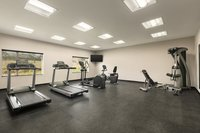 Spacious fitness center at our UVA hotel