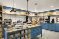 Bright blue breakfast room with hot and cold items