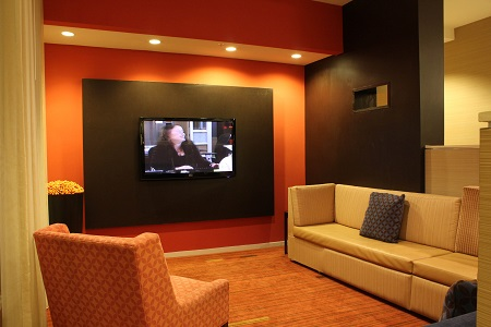 Lobby area with big-screen TV and couches