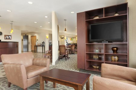 Inviting lobby with TV, chairs and coffee table