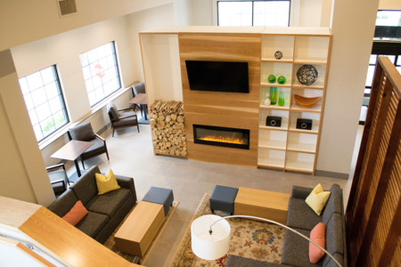 Welcoming lobby with a modern fireplace and comfortable seating