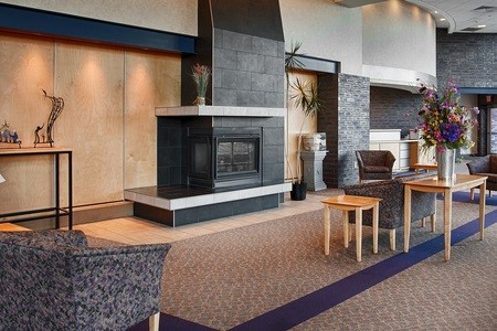 Spacious lobby with seating and fireplace