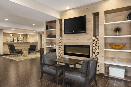 Spacious lobby with fireplace, seating and flat-screen TV