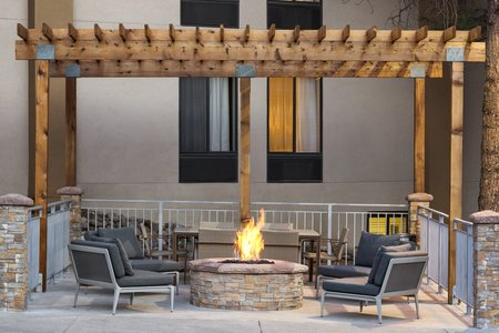 Outdoor patio with fire pit and seating in Flagstaff