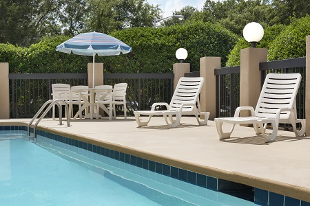 Outdoor pool and chaise lounges at Fort Mill hotel
