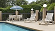 Outdoor pool and seating at the Country Inn & Suites