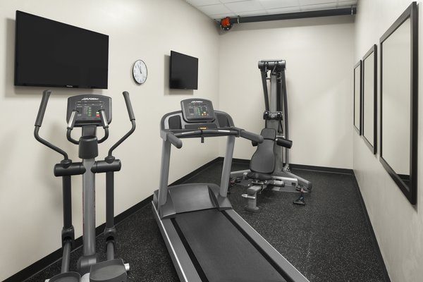Fitness center with treadmill, elliptical and weight machine