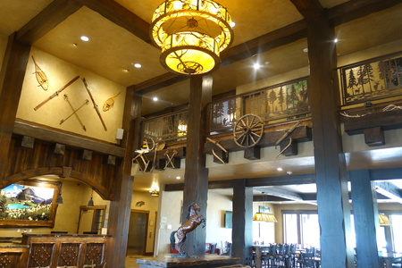 Hotel lobby with skis, snowshoes and western decor mounted on the walls