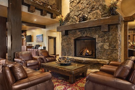 Hotel lobby with a stone fireplace and comfortable, brown leather furniture