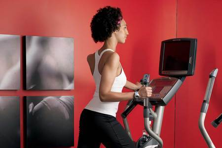 Woman using the elliptical machine