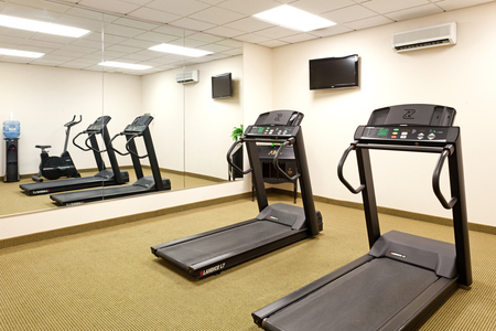 Fitness center featuring treadmills and TV