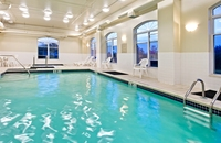 Indoor pool area with large windows