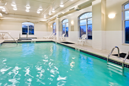 Bright, sparkling indoor pool and hot tub